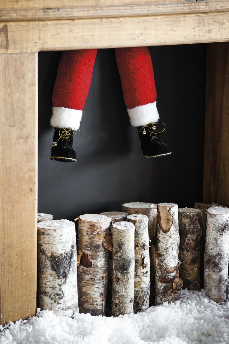 Features: -Material: Plush fabric. -1 Santa leg on a stake. -Red pant leg with fur trimmed bottom and black boots. Product Type: -Decorative Accents. Color: -Red. Holiday Theme: -Yes. Seasonal