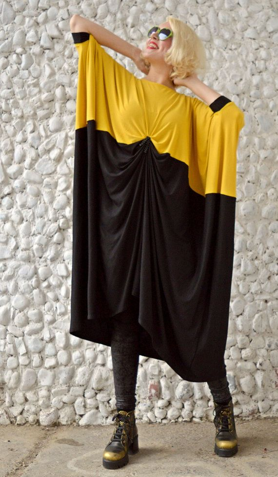 Funky bicolor kaftan with asymmetrical cut and a very stylish mix of black and mustard. Made of the finest viscose, this loose dress is very soft at touch, very comfortable and fun to wear. Very classy piece, versatile, that will for sure steal the spotlight!  Material: 95% viscose, 5% elastane Care instructions: Wash at 30 degrees  The model in the picture is size S.  Can be made in ALL SIZES.  If you have any other specific requirements, do not hesitate to contact me!  I DO NOT CHARGE…