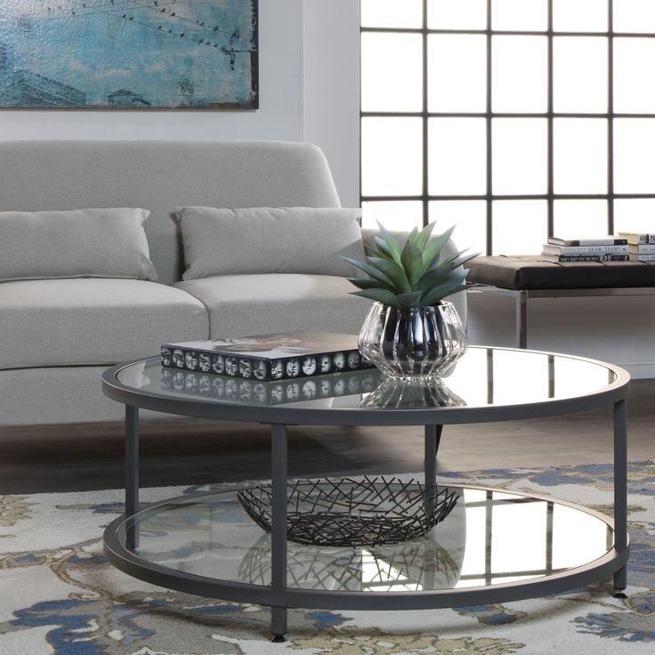 Make your friends jealous with this chic looking Round Coffee Table. This coffee table offers spacious dual tempered glass surfaces for displaying books and more, or for added serving space when entertaining.