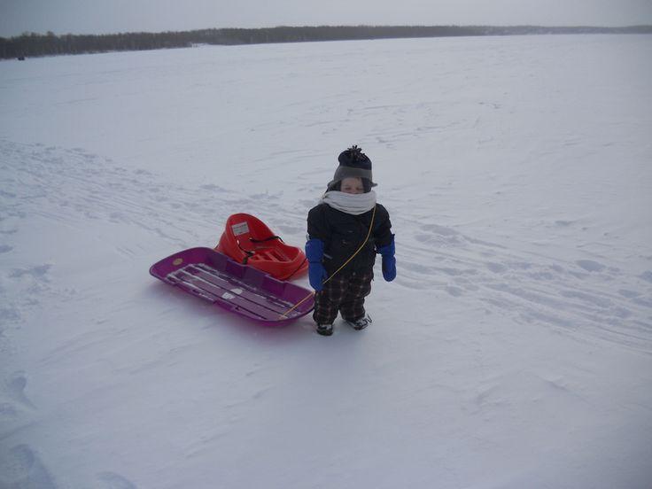 Trekking across Lucien Lake in the winter time #lucienlake #winterfun #sledding #winteratthelake