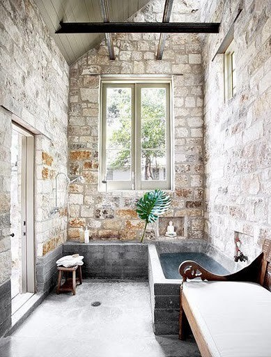 Rustic stone bathroom with vaulted ceilings