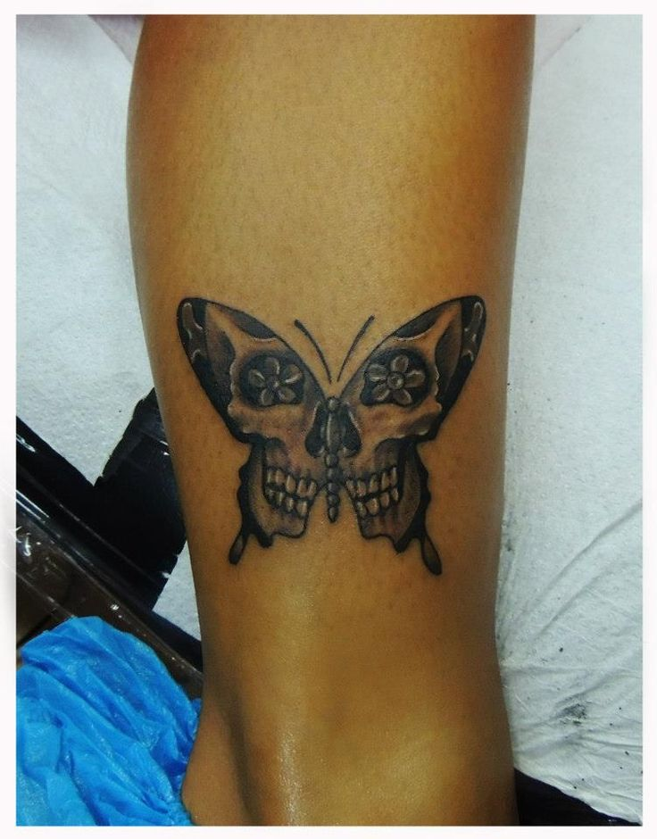 Skull Butterfly tattoo by ErvinTattoo