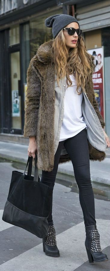 Opt for a brown fur coat and black leggings for an effortless kind of elegance. Take a classic approach with the footwear and grab a pair of black studded leather ankle boots.   Shop this look on Lookastic: https://lookastic.com/women/looks/fur-coat-denim-shirt-crew-neck-t-shirt/15359   — Grey Beanie  — Brown Fur Coat  — White Crew-neck T-shirt  — Grey Denim Shirt  — Black Leggings  — Black Suede Tote Bag  — Black Studded Leather Ankle Boots
