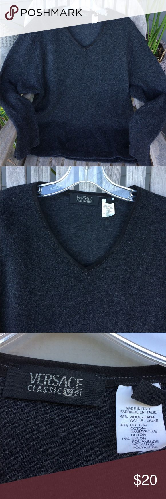 Versace pure wool men's v neck sweater Gorgeous soft 100 % wool Versace sweater. Nice suede piping at v neck.  Nice loose fit so you can layer with shirts underneath.  Casual and stylish. Excellent condition Versace Sweaters V-Neck