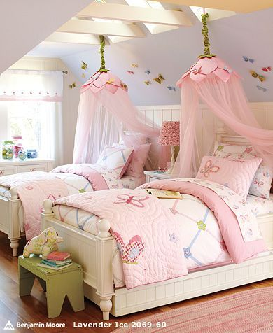 cute bedroom for two girly girls     I love the soft colors in this beautiful girls shared bedroom from Pottery Barn Kids. The bed canopy over each twin bed adds a nice feminine touch.
