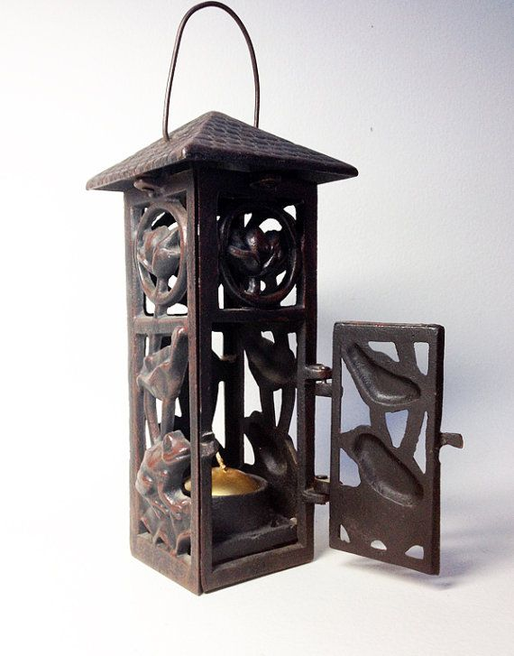 French Vintage Cast Iron Lantern with Frog Decor - Cast Iron Lantern with One Opening Door. Stable and heavy lantern. The four sides are the