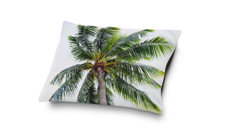 A beach tropical bedding accent for your four-legged home companion, this  pet bed pillow style accessory features coral fleece top side display of a  lush caribbean green coconut palm tree throughout! Available in three  different sizes to choose from, this dog and cat pet pillow style bedding  accent makes for a great nap-time gift for any lovable furry home  companion!   * Available in 18x28, 30x40 and 40x50 Inches