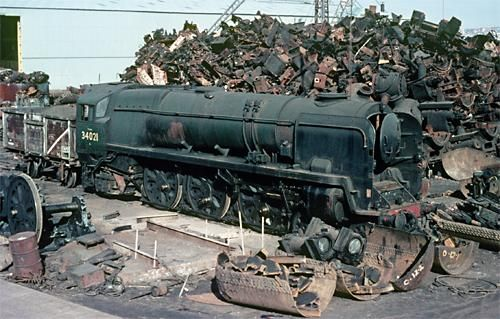 34021 was a SR West Country/Battle of Britain class locomotive. Built in 1945 'DARTMOOR' served SR until July 1967, when it was withdrawn from service. Seen here at Cashmore's (Newport) yard in March 1968, just prior to being broken up ..... it is already devoid of the 'air smooth' boiler casings, a familiar feature of this class.