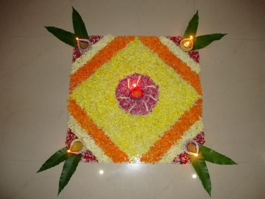 rangoli designs made out of flowers specially for the festival of!!