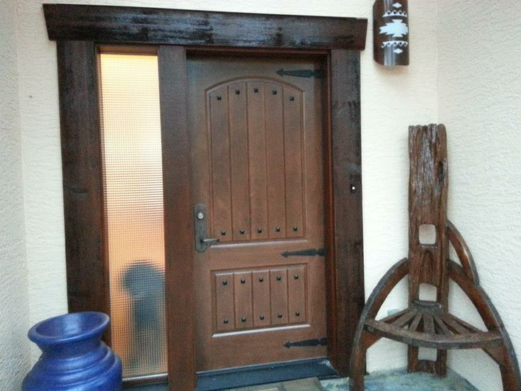 Rustic Door: Complete with clavos and strapping to bring the whole look together.  Custom stained Fibre glass header and trim help to solidify the look.