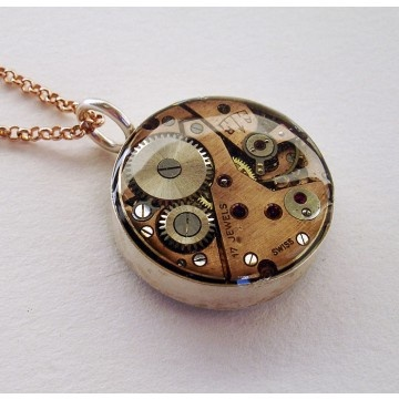 A precious mom deserves a precious and unique jewel by an Italian artisan. Double-sided recycled vintage watch pendant in sterling silver and rubies, with rose-gold plated silver chain.