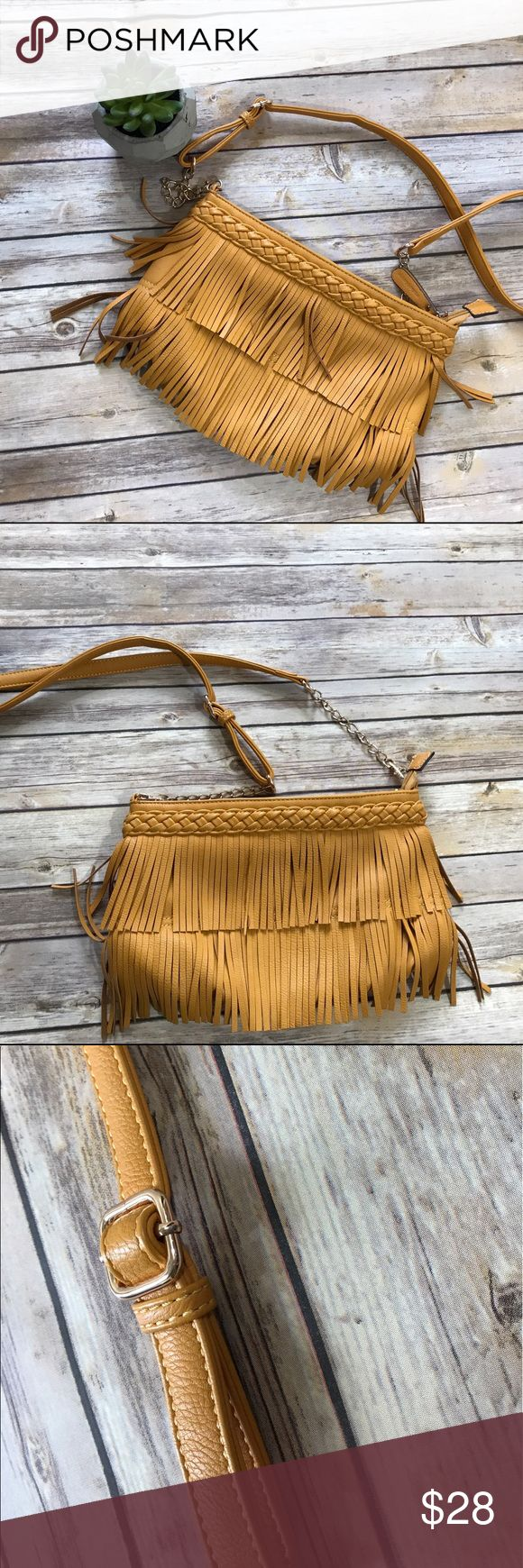"""Melie Bianco mustard yellow fringe Crossbody bag Cruelty free vegan leather. Strap length 23"""", height 7"""", width 12"""". Small stain/ wear on back (see last photo) Melie Bianco Bags Crossbody Bags"""