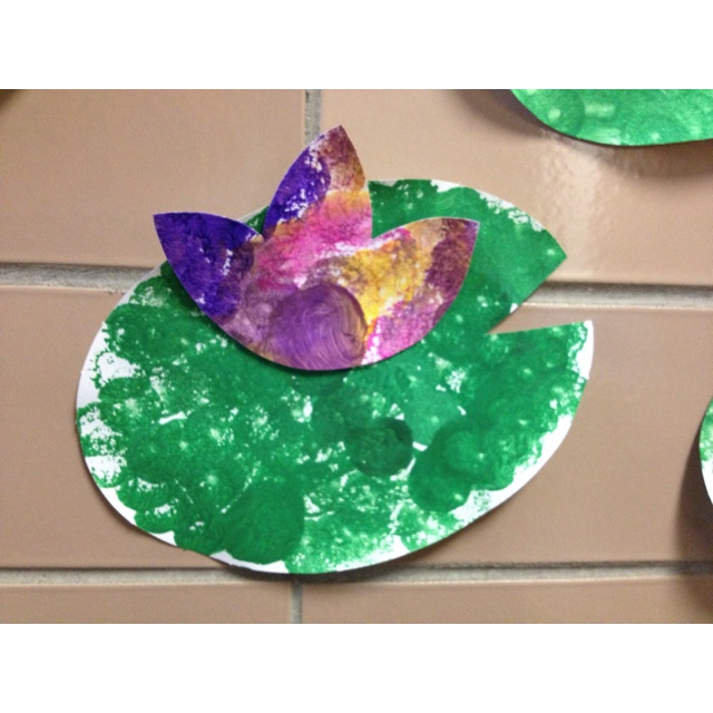 Monet- water lillies. I had each student uses a circle sponge and dot all over the oval paper. The dots were helping it look for demensintal and then they needed to paint a flower with the same circle sponge.
