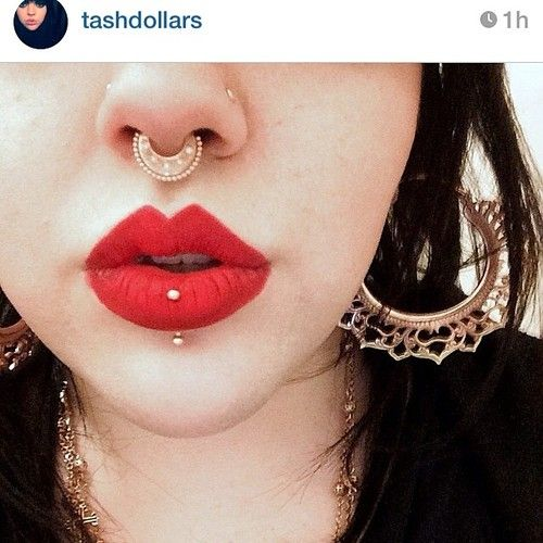 ironcladtattooco: Our awesome friend @Natasha Vranic is definatly a gold queen. Her nostrils, septum, and vertical labret piercings are all ro...