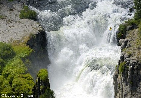 Kayaker Jesse Coombs, runs the 70ft-tall Lower Mesa Falls on Henry's Fork River in Idaho