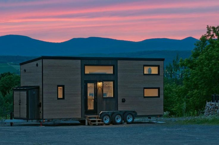 The Acacia is a modern tiny house built by Quebec-based Minimaliste. A main floor bedroom, loft bedroom, and sofa bed provide plenty of sleeping options.