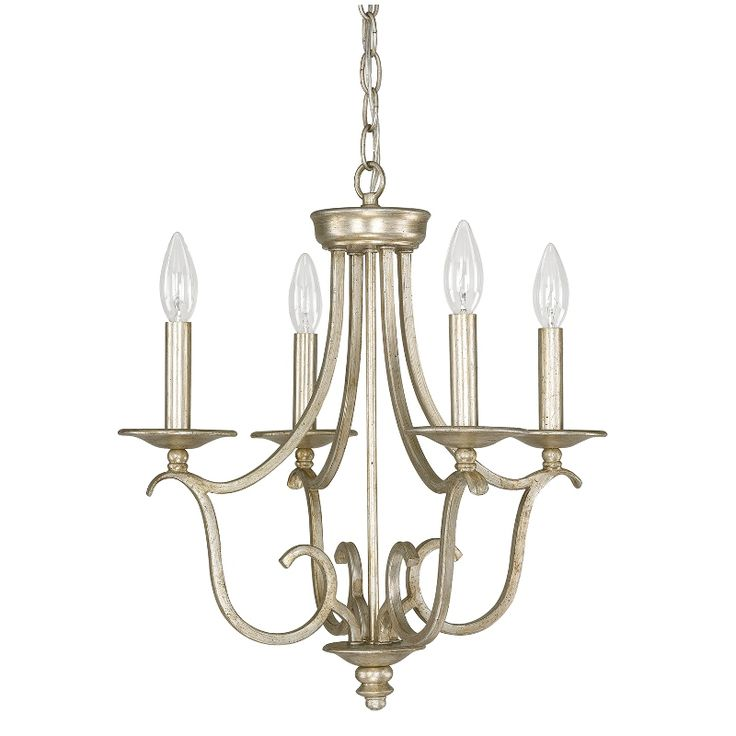add an elegant touch to your living room or entryway with this lovely mini chandelier showcasing a scrolling design and winter gold finish