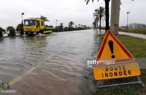 A tow truck drives on a flooded road during heavy rains in... #lesrosiers: A tow truck drives on a flooded road during heavy… #lesrosiers
