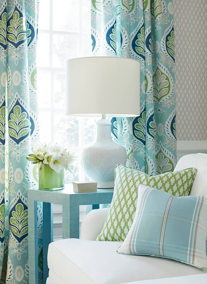 how to integrate blue, white and green pattern in chair cushions and wallpaper, turquoise side table, white lamp