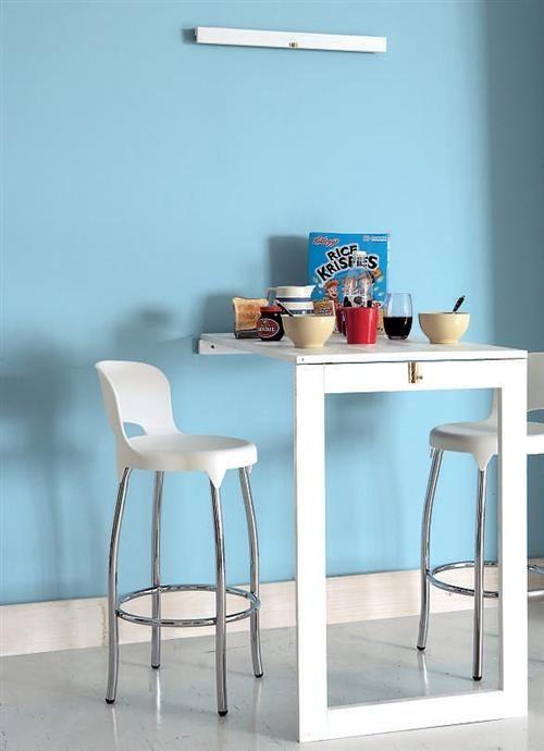 Una mesa plegable de cocina puede servir como un lugar para comer o una encimera adicional mientras cocinas. | 27 Soluciones vitales para tu pequeña cocina