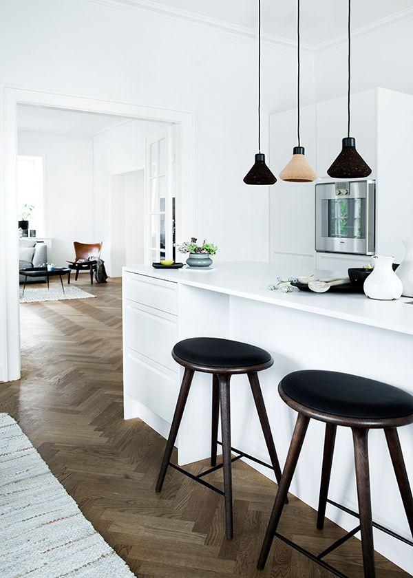 pretty perfect pendants in a beautiful white kitchen, herringbone wood floors