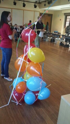 Balloon and straw tower. Competition and activity to promote group work, team work, etc. Give teams tape, balloons, and straws. Give them a time limit. The goal is to create the tallest structure that can stand alone.