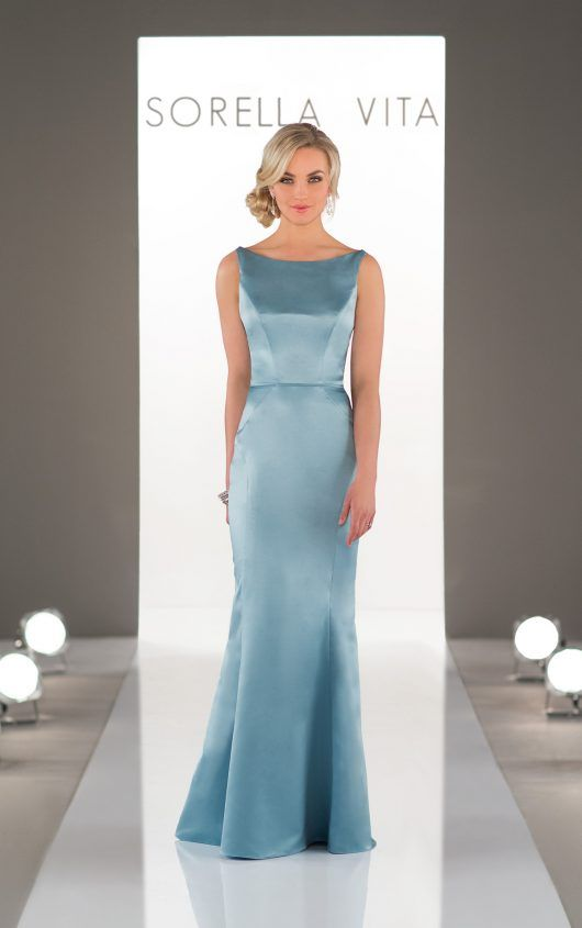 Style: 8918. Sophisticated satin bridesmaid dresses have never looked more glamorous than this stunning style. A high, wide neckline provides a classic silhouette and frames the face effortlessly before cinching in at the waist, creating an enviable hourglass shape. The sheath silhouette of this gown features visible seaming, which both flatters and elongates the body. The back of this gown dips into a slight V and is accented beautifully with four thin straps.