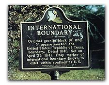 The only marker of international boundary known to exist within the Continental United States is located west of Joaquin, Texas. The marker is located on the Texas-Louisiana border about fifty yards north of Texas Farm Road 31. The site was once the boundary between the United States and the Republic of Texas in 1840.