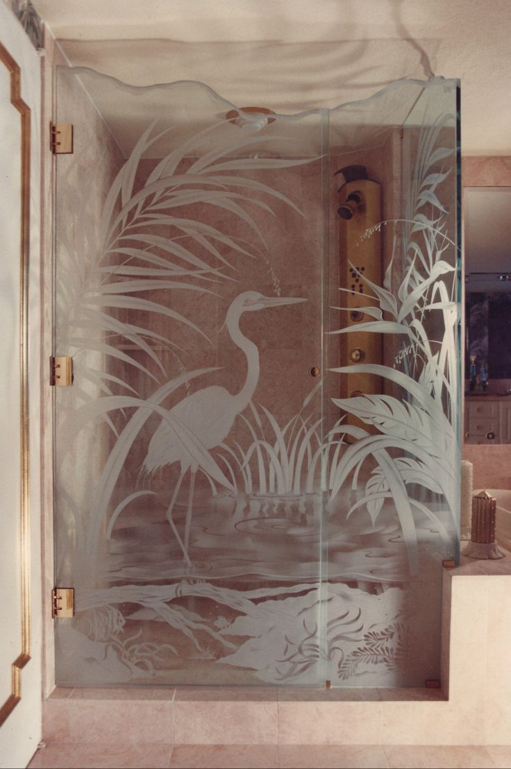 Add a little more life to a glass shower.  Fish, birds, tropical leaves, ballerinas and more. We design to suit. I even etched a guys wife petting a lion on a shower door.  Yes it was a good likeness.
