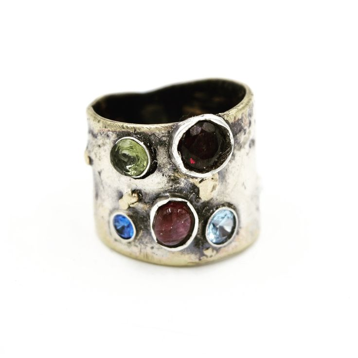 Art Jewelry;  Brass, Sterling silver and 18k Gold ring, set with Peridot, Ruby, Zircon, pink Tourmaline and Aquamarine