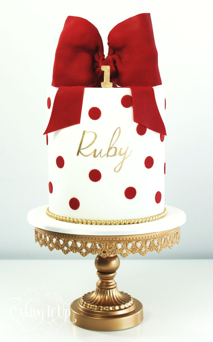 Red polka dot cake with pretty bow http://www.facebook.com/cakingitup