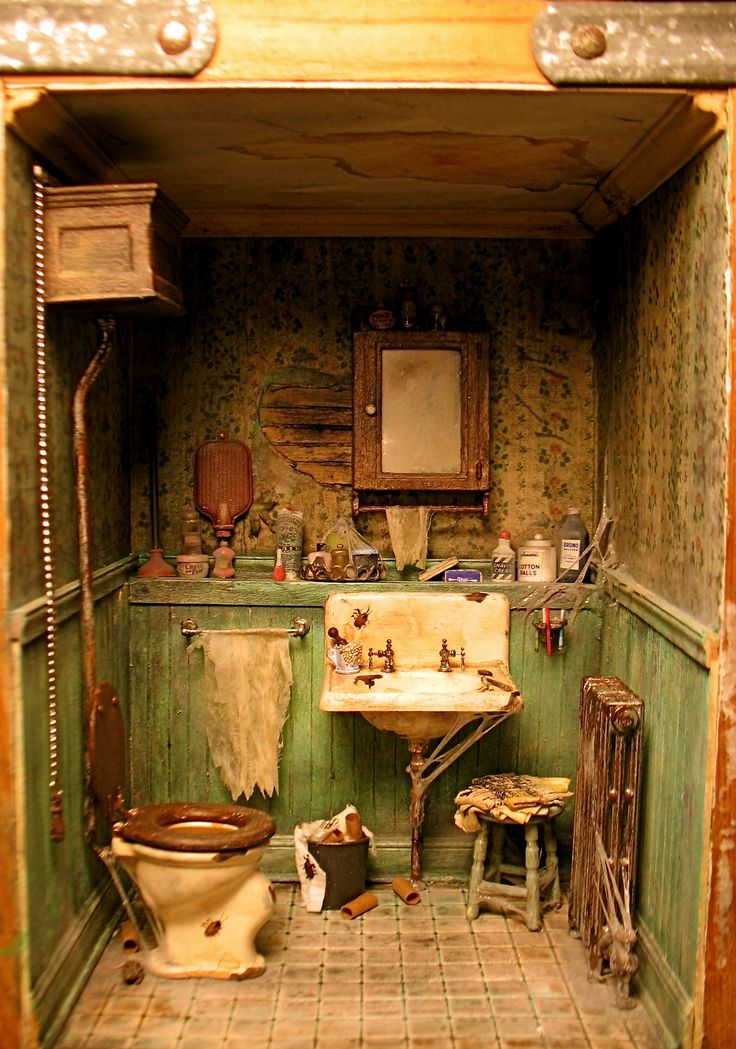 1:12 scale miniature grungy bathroom by Patricia Paul.