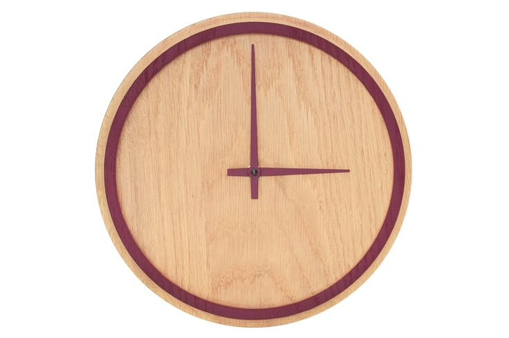 "Strict minimalism, clear geometry and fresh colours – these are the characteristics of the solid wood wall clock ""Madera""."