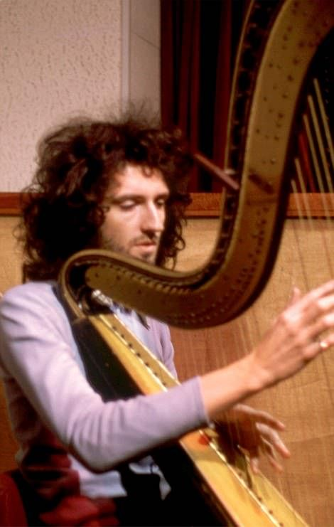 Different strings: The 3-D book features a photo of the band's guitarist strumming a harp