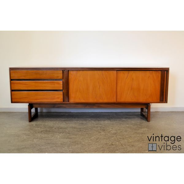Vintage 1960s teak sideboard in a warm colour and with beautiful clean lines. Check our shop for more mid-century modern sideboards, chairs, tables and more