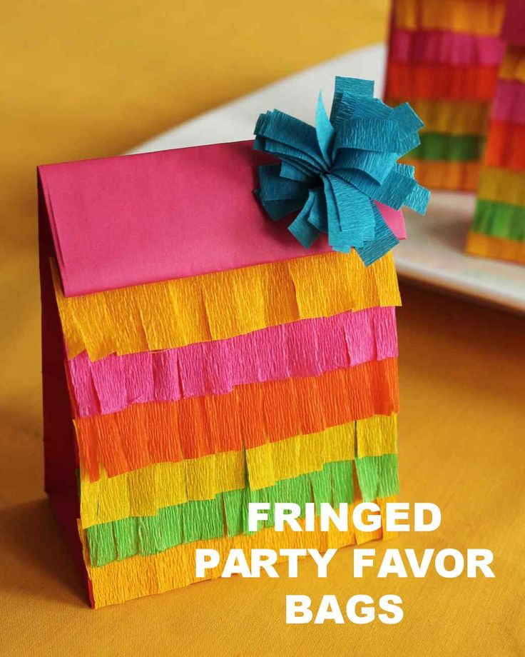 Fringed Party Favor Bags | Martha Stewart Living - These fringed goody bags are perfect for any fiesta! Fill them with take-home treats like Mexican hot chocolate cookies, Mexican chocolate biscotti, spiced hot chocolate, or easy no-fry churros.
