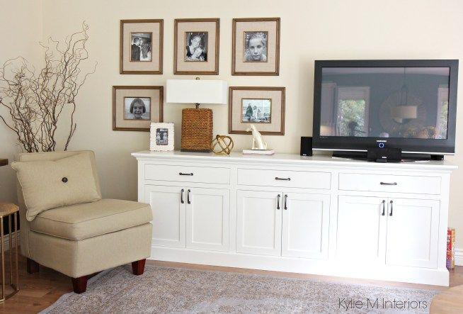 Custom TV cabinet painted Cloud White with photo gallery. Benjamin Moore Gentle Cream on walls