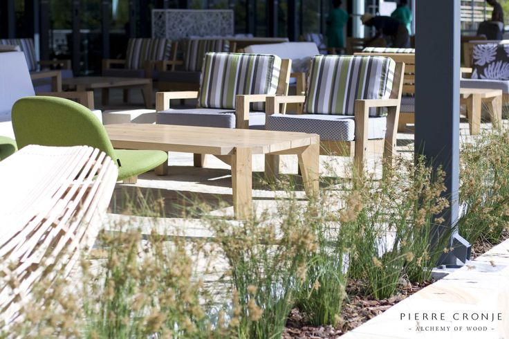 The outdoor area at Leopards Leap in Franschhoek, South Africa. Interior design by Christiaan Barnard, solid wood furnishings and shopfitting by Pierre Cronje