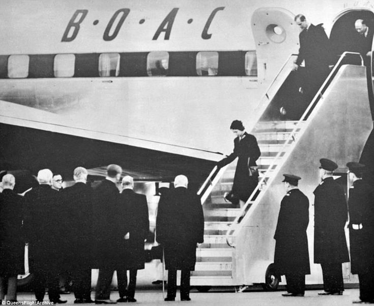 Winston Churchill and Clement Attlee greet Princess Elizabeth on her return to London from...