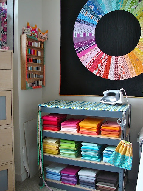 ironing board on a shelf... this seems infinitely more practical than the typical freestanding board! and her whole studio is gorgeous...