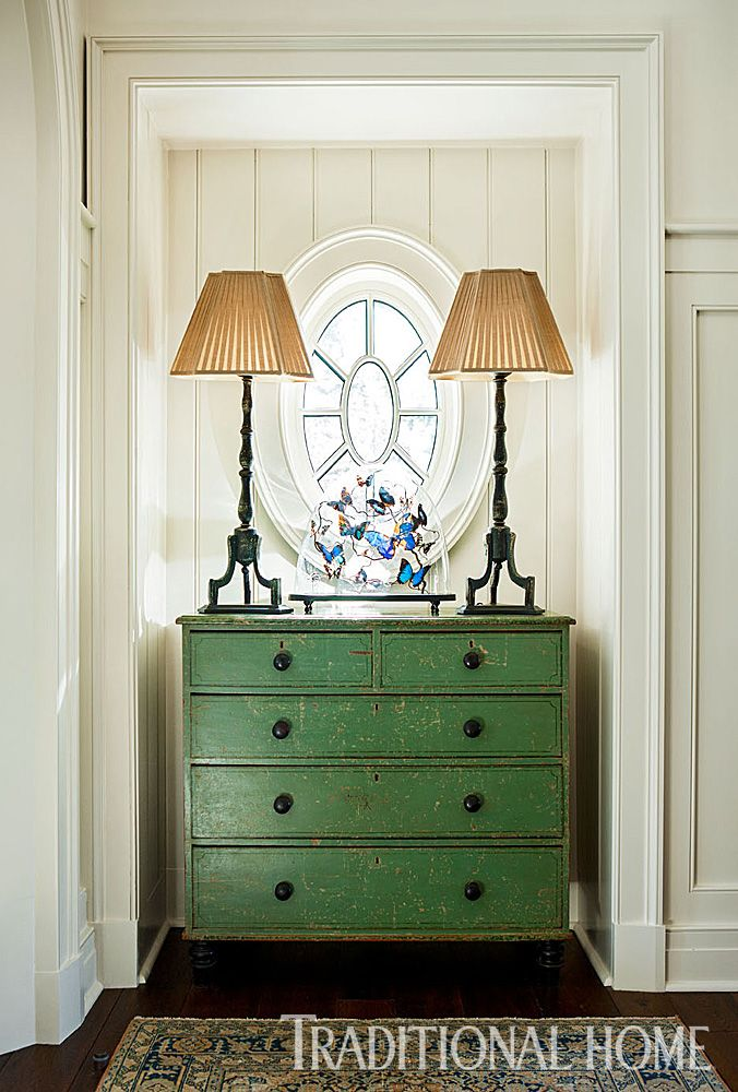 The distressed green chest in the entry evokes a carefree air fitting of this vacation home. - Photo: Erica Dines / Design: Tammy Connor