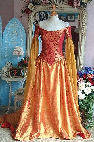 Medieval Pandora Gown with red/gold corset bodice, chiffon hanging sleeves, and matching silk skirt.  From Rossetti Costumes and Bridal Gowns.