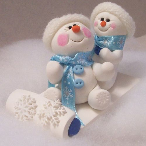 so cute - snowmen on a sled