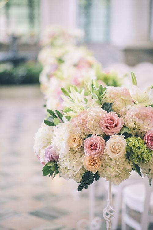 Beautiful Aisle decor with white, pink and cream colour garden roses and hydrangeas