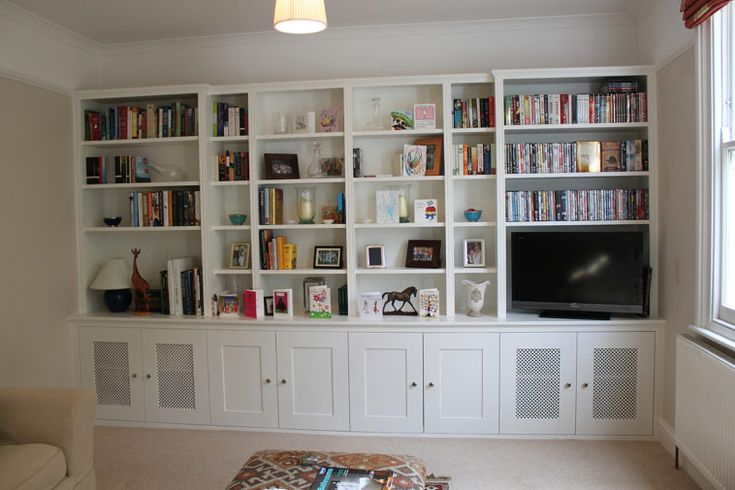 White Stained Wood Built In Book Cabinet With Shelf And Storage Underneath