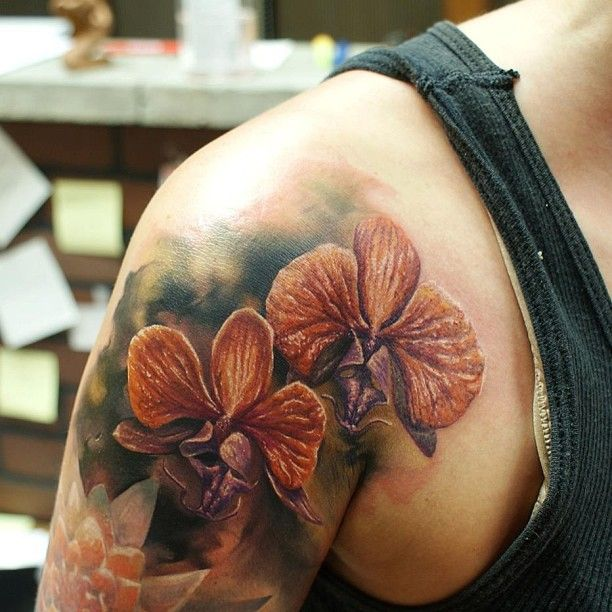 25 best ideas about orchid flower tattoos on pinterest for Wyld chyld tattoo pittsburgh