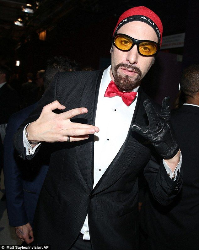 Sacha Baron Cohen brings back Ali G to support 'Idis Elbow' and Will Smith in racially-charged Oscars skit
