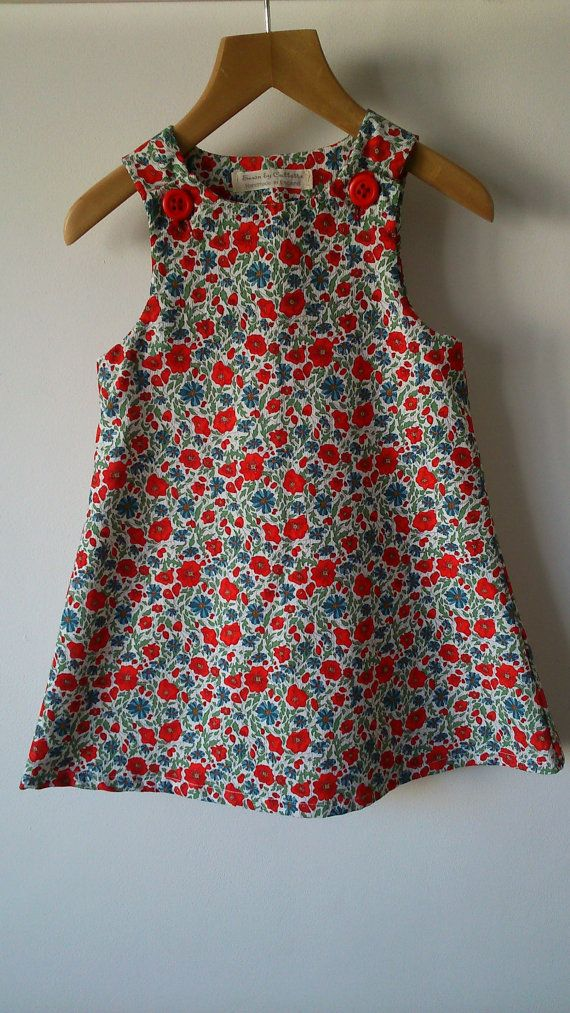 This Liberty A line girls pinafore dress is in a needlecord.  It is a lovely traditional little girls dress.