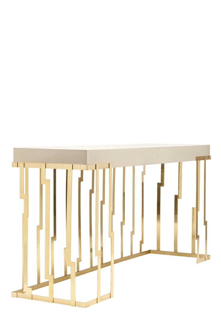 Cliff Console . Earth To Earth Collection . New Piece  The metal verticals with cascating drawing of the Cliff console remembers us how the sea carves the rocks originating the texturized cliffs. The piece has their beauty in the repeated metal pattern in polished brass with a top  rectangular stone colour lacquer with gloss finishing.