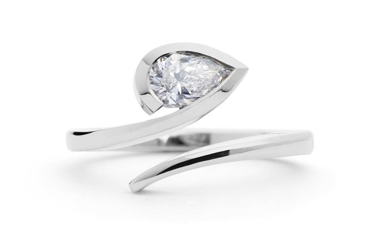 White pear diamond and platinum Twist engagement ring, from £1,800, McCaul